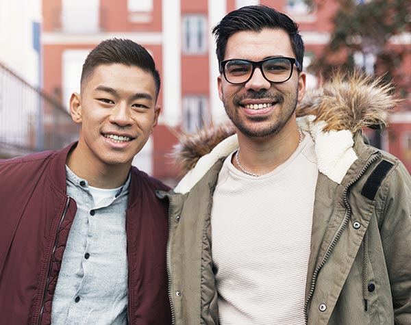 two young men friends outside city